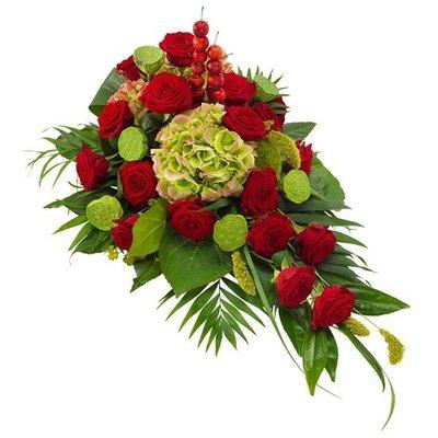 Rouwarrangement in rood en groen